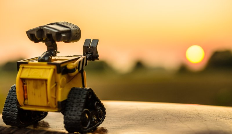 Wall-e robot waving in a sunset
