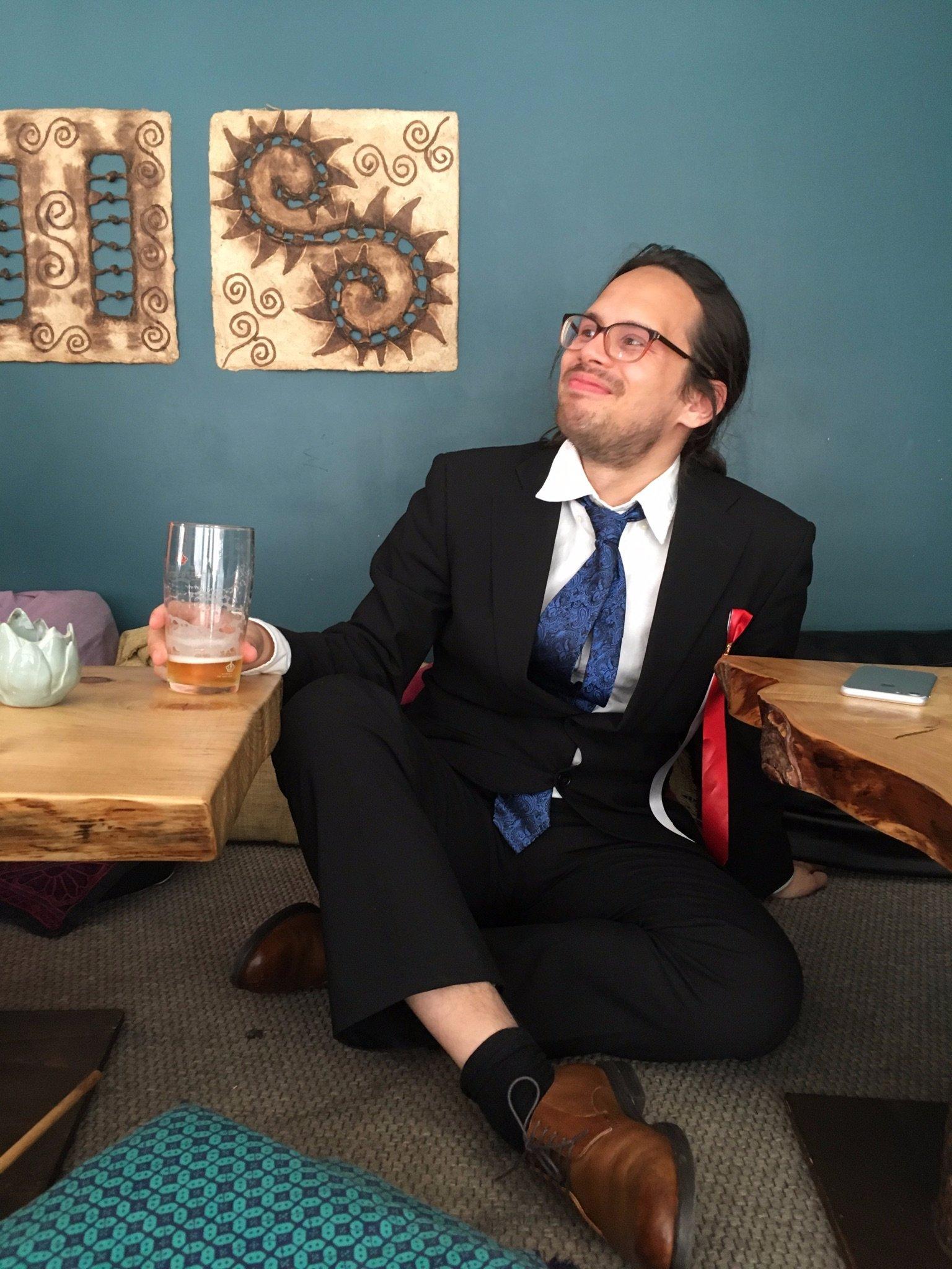 Nils sitting at a bar, smiling.