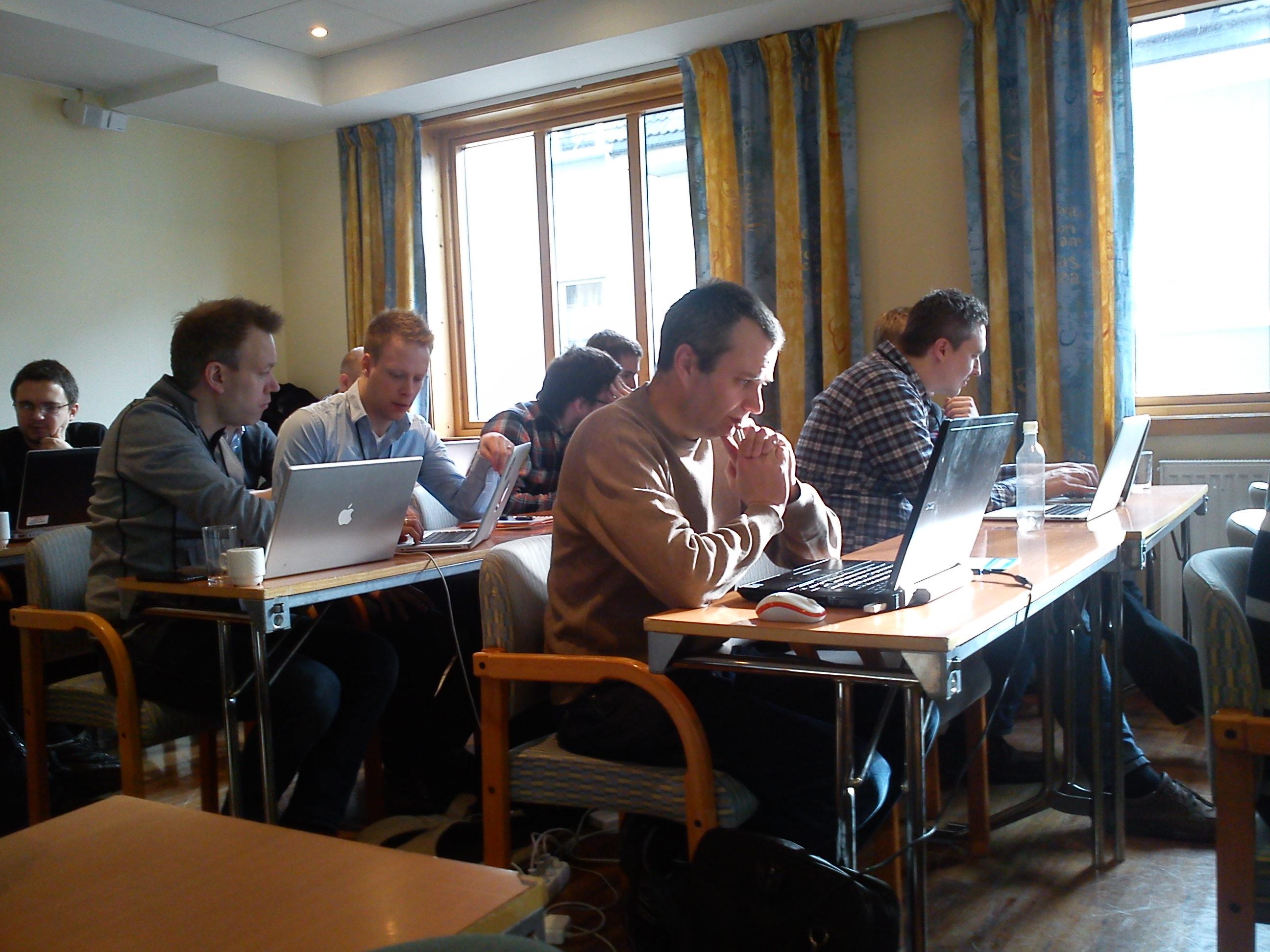 People solving a coding kata through pair programming